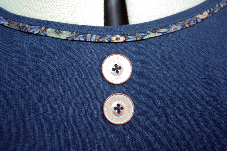 the neckline with buttons